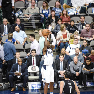 BARNES 21 POINTS LIFT MAVS IN WIN OVER NETS