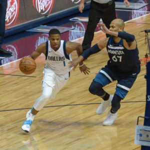 T'WOLVES DEFEAT MAVS